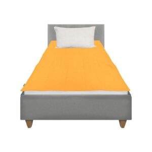 Grey cotton weighted blanket lies on top of the bed with no overhang
